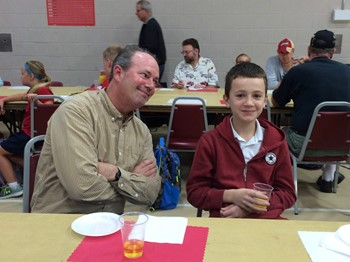This father and son enjoy an morning together at Dads and Donuts