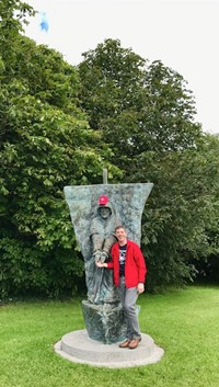 Fr. Tom Woost in Ireland with fountain Statue of St. Brendan