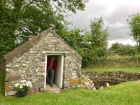 Fr. Tom Woost in Ireland in doorway of St. Brendan's house
