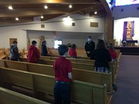 students pray with fr tom before receiving the sacrament of reconciliation