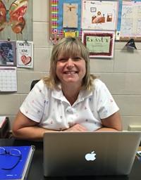 Mrs. D at her desk